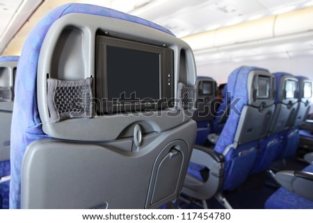 LCD monitor on Passenger Seat of airplane with empty copy space - stock photo