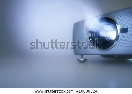 LCD video projector at business conference or lecture with copy space - stock photo