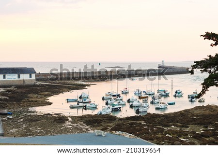 LE CROISIC, FRANCE - JULY 26, 2014: mooring in urban port in Le Croisic town France at sunset. Le Croisic is town in Loire-Atlantique department in western France on Atlantic coast - stock photo
