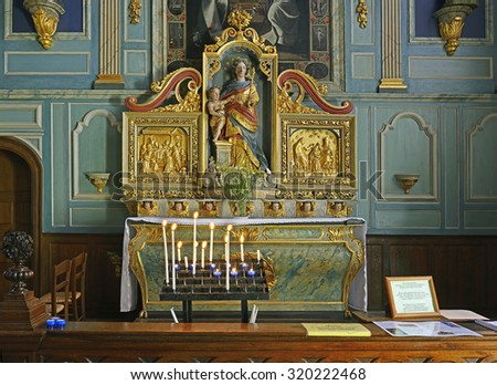 LE FAOU, FRANCE - JULY 6, 2015: Gilded altar of hurch St. Sauveur Ouverte in Le Faou. Le Faou is a commune in the Finistere department of Brittany in north-western France.