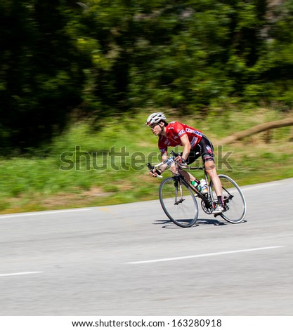 Le Garcin, FRANCE -Â?Â? July 6: Racer in The Marmotte Race, French Alps, July 6, 2013 covering 174km, including Col du Glandon, Col du Galibier, the most feared Tour de France mountains. - stock photo