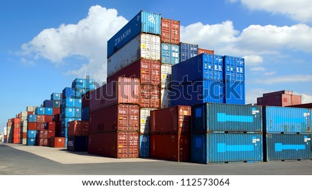 LE HAVRE, FRANCE - AUGUST 09: Shipping containers at the docks of the Havre. One of the largest ports of France's . The port includes 6.5 kilometres of docks; August 09, 2012 in Le Havre, France. - stock photo