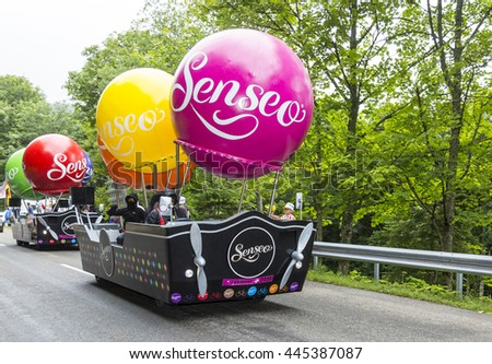 LE MARKSTEIN, FRANCE - JUL 13: Fancy vehicle of Senseo during the passing of the publicity caravan on the road to mountain pass Le Markstein during the stage 9 of Le Tour de France on July 13, 2014