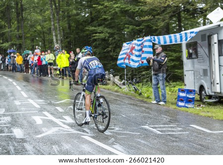 LE MARKSTEIN, FRANCE - JUL 13:The Canadian cyclist Christian Meier of Orica-GreenEDGE Team , climbing the road to mountain pass Le Markstein during Le Tour de France on July 13, 2014