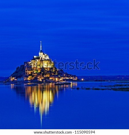 Le Mont Saint Michel, an UNESCO world heritage site in France, with reflection in the evening