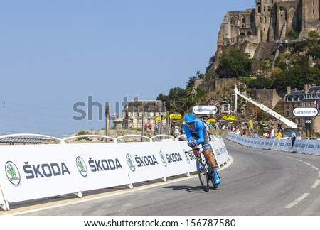 LE MONT SAINT MICHEL,FRANCE-JUL 10:The New Zealander cyclist Jack Bauer from Garmin-Sharp Team cycling during the stage 1(time trial Avranches -Mont Saint Michel) of Le Tour de France on July 10, 2013 - stock photo