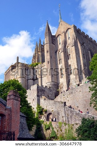 LE MONT SAINT MICHEL, FRANCE - MAY 30: The ancient village of Mont Saint Michel, old traditional colorful houses and its roofs. Le Mont Saint Michel, France - May 30, 2014 - stock photo