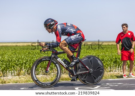 LE PONT LANDAIS,FRANCE-JUL 10:The Italian cyclist Manuel Quinziato from BMC Racing Team cycling during the stage 11(time trial Avranches -Mont Saint Michel) of Le Tour de France on July 10, 2013 - stock photo