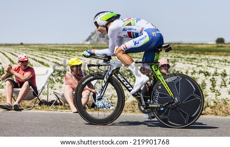 LE PONT LANDAIS,FRANCE-JUL 10:The South African cyclist Daryl Impey from Orica-GreenEDGE Team cycling during the stage 11(time trial Avranches -Mont Saint Michel) of Le Tour de France on July 10, 2013 - stock photo