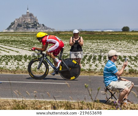 LE PONT LANDAIS,FRANCE-JUL 10:The Spanish cyclist Luis Angel Mate Mardones from Cofidis Team cycling during the stage 11(time trial Avranches -Mont Saint Michel) of Le Tour de France on July 10, 2013 - stock photo