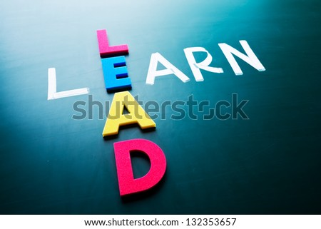 Lead and learn, conceptual words on blackboard