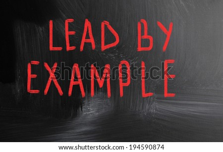 lead by example handwritten with chalk on a blackboard - stock photo