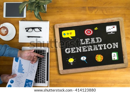 LEAD GENERATION Businessman working at office desk and using computer and objects, coffee, top view, - stock photo