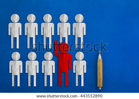 leader concept with red man paper cut on blue leather background