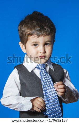 Leader, cute little boy portrait over blue chroma background