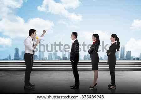 Leader give order via megaphone to his subordinate. Business communication concept - stock photo