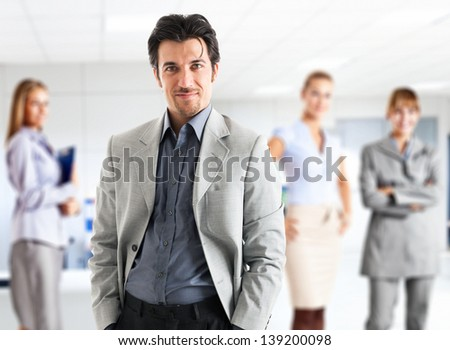 Leader in front of his business team - stock photo