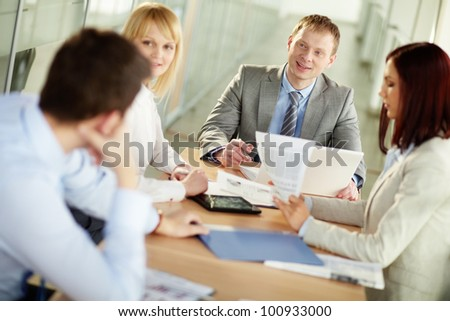 Leader of a business group encouraging his colleagues to bring forward their ideas