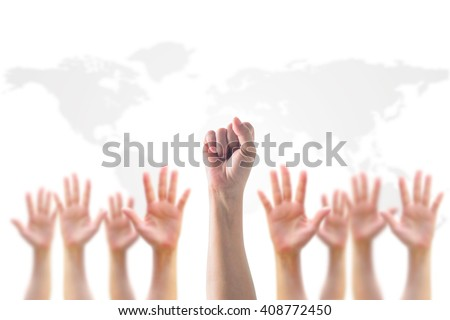 Leader's fist victory sign among blur human hands crowd group: Many people blurred palms raising up upward on white background map: World participation, leadership, volunteer recognition concept  - stock photo