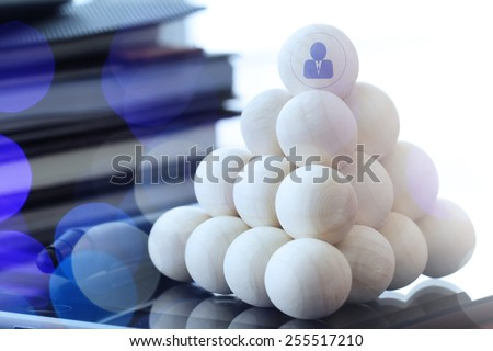 Leadership business concept,people icons on wooden balls on digital tablet computer - stock photo