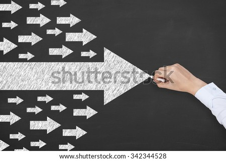 Leadership Concept Arrow on Chalkboard - stock photo