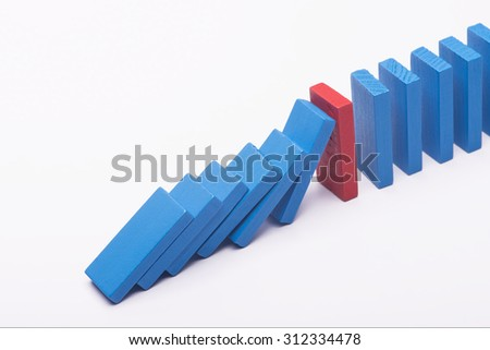 Leadership concept colourful dominos over white background - stock photo