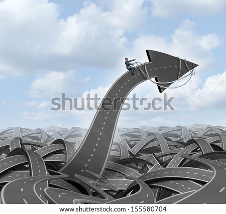 Leadership direction guidance business concept with a group of tangled streets and highways and a businessman guiding and steering an arrow road using a harness towards a planned goal for success. - stock photo