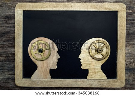 Leadership education symbol concept. Two human heads with gears