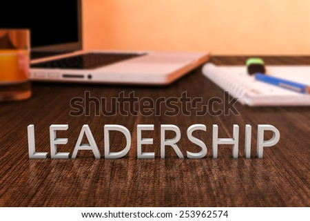 Leadership - letters on wooden desk with laptop computer and a notebook. 3d render illustration. - stock photo