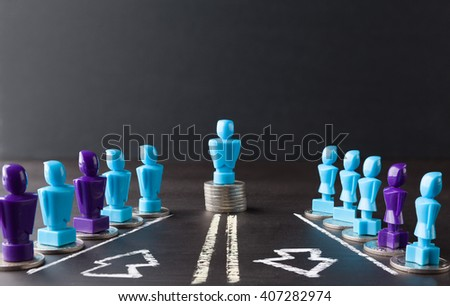 Leadership, money, wage, and gender equality concept depicted with female and male figurines standing on top of coins. - stock photo
