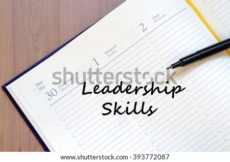 Leadership skills text concept write on notebook with pen