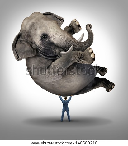 Leadership solutions business concept as a take charge businessman lifting an elephant as an icon of a leader with courage and determination to release the power within and achieve the impossible. - stock photo