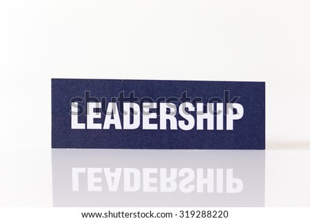 LEADERSHIP written on Paper Showing Commercial Concept