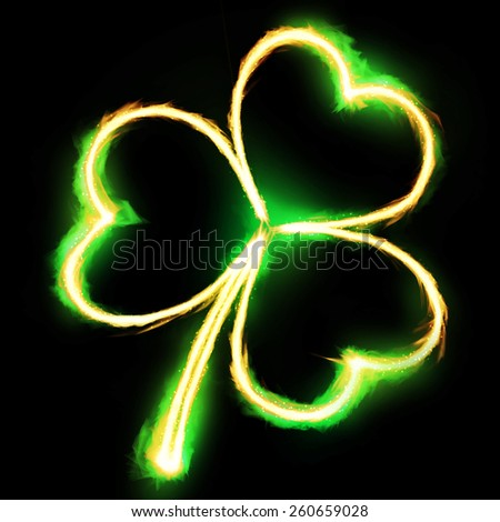 Leaf clover on fire - stock photo