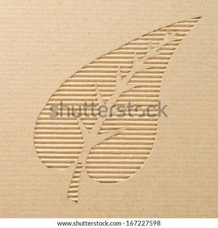 Leaf cut out on a corrugated cardboard   - stock photo