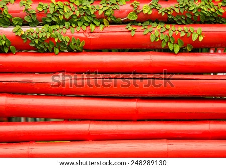 leaf on red bamboo background - stock photo