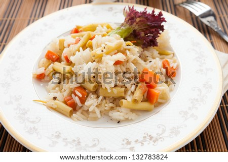 lean boiled rice with vegetable mix, closeup