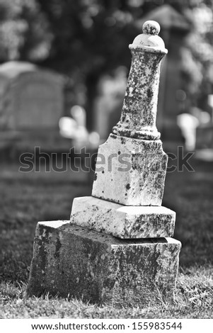 Leaning Headstone - Black and White of a Leaning Headstone - stock photo