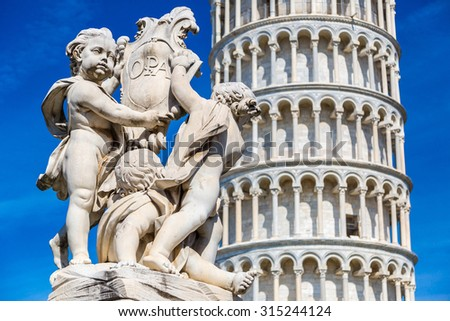 Leaning  tower in Pisa with statue of angels   in a summer day in Italy - stock photo