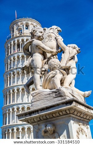 Leaning  tower in Pisa with statue of angels in a summer day in Italy