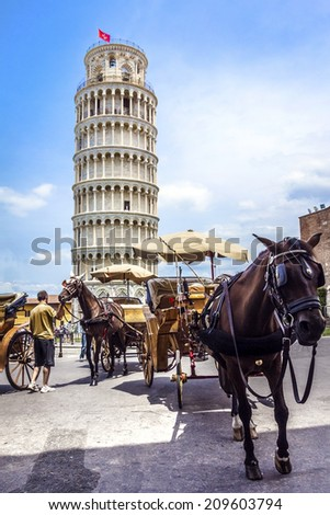 Leaning Tower of Pisa in Tuscany, a Unesco World Heritage Site and one of the most recognized and famous buildings in the world. - stock photo