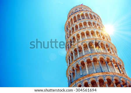 Leaning Tower of Pisa, Italy, Europe. Tower of Pisa Over Blue Sky. Italian Architecture. - stock photo