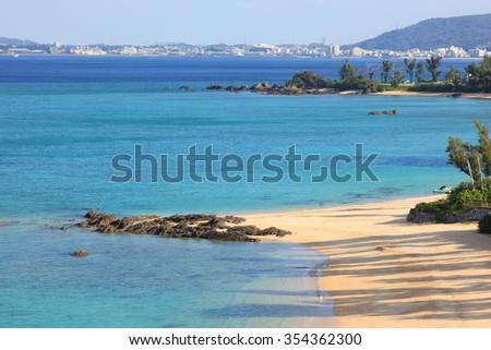 lear blue water, coral reef and deserted white sand tropical beach of Kerama Islands, Okinawa, Japan
