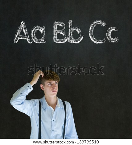 Learn alphabet write writing man teacher on chalk blackboard background - stock photo