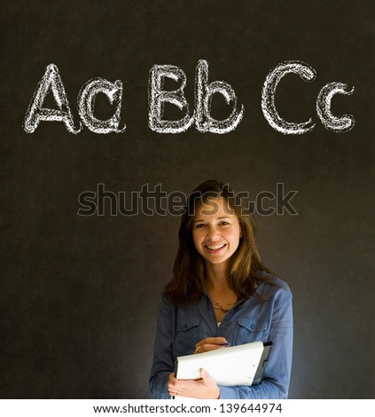 Learn alphabet write writing woman teacher on chalk blackboard background - stock photo