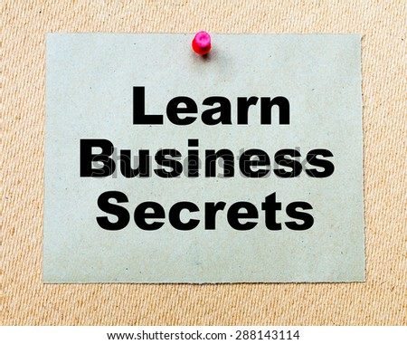 Learn Business Secrets written on paper note pinned with red thumbtack on wooden board. Business conceptual Image - stock photo