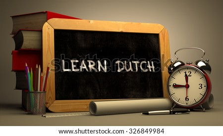 Learn Dutch Concept Hand Drawn on Chalkboard. Blurred Background. Toned Image. - stock photo