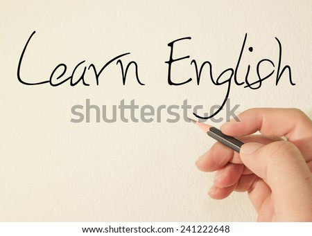 learn English text concept write on wall  - stock photo