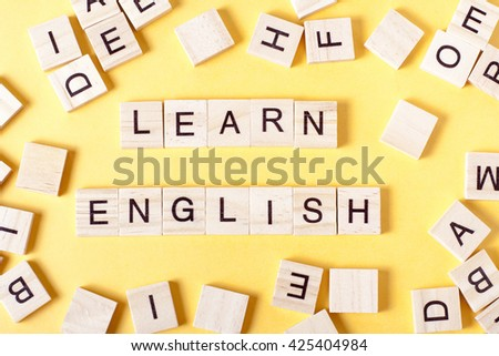 Learn English text on a wooden background. - stock photo