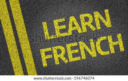Learn French written on the road - stock photo
